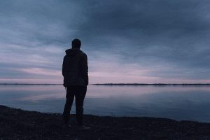 man near sea in loneliness